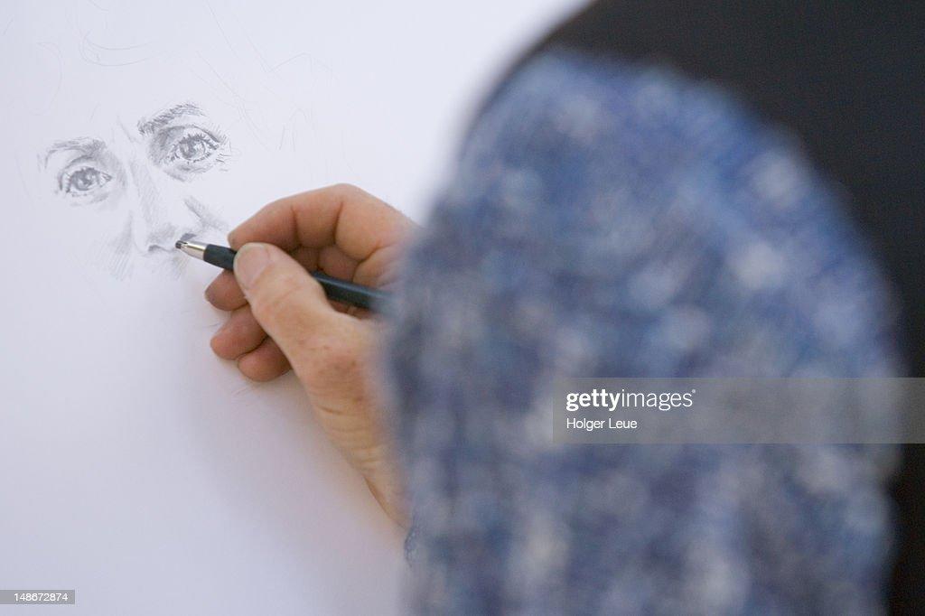 Artist drawing portrait in Piazza IV Aprile. : Ilustração de stock