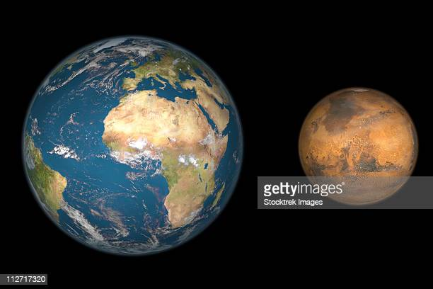 Artist's concept comparing the size of Mars with that of the Earth.