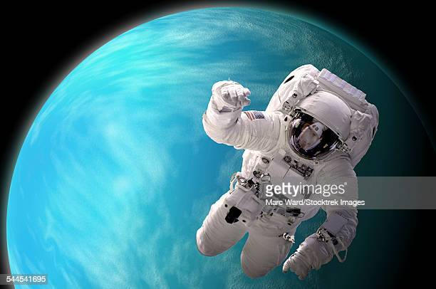Artists concept of an astronaut floating in outer space by a water covered planet.