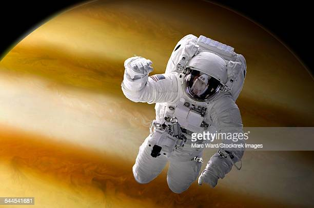 Artists concept of an astronaut floating in space above a large, alien planet.
