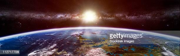 illustrazioni stock, clip art, cartoni animati e icone di tendenza di artist's concept of an extraterrestrial planet showing the sun and a galaxy on the horizon. - orbiting