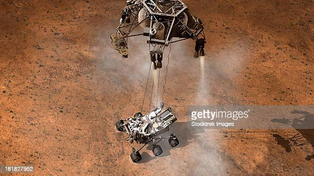 artist's concept of nasa's curiosity rover touching down onto the martian surface. - landing touching down stock illustrations