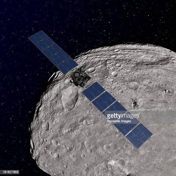 Artist's concept showing NASA's Dawn spacecraft orbiting the giant asteroid Vesta.
