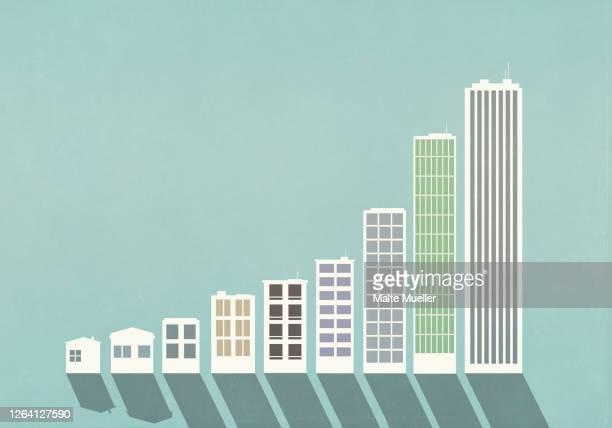 ascending buildings forming bar graph - development stock illustrations