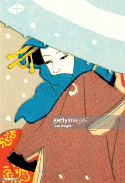 アジアの女性の雪