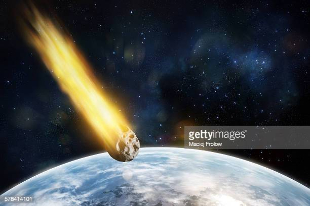 asteroid entering blue`s planet atmosphere - space and astronomy stock illustrations