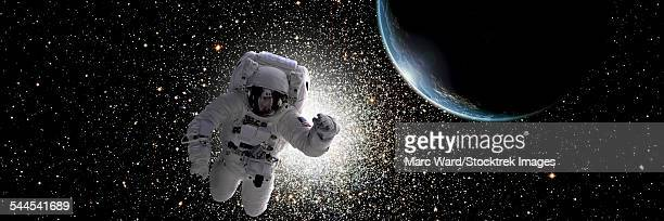 Astronaut floating in deep space with an Earth-like planet in background.