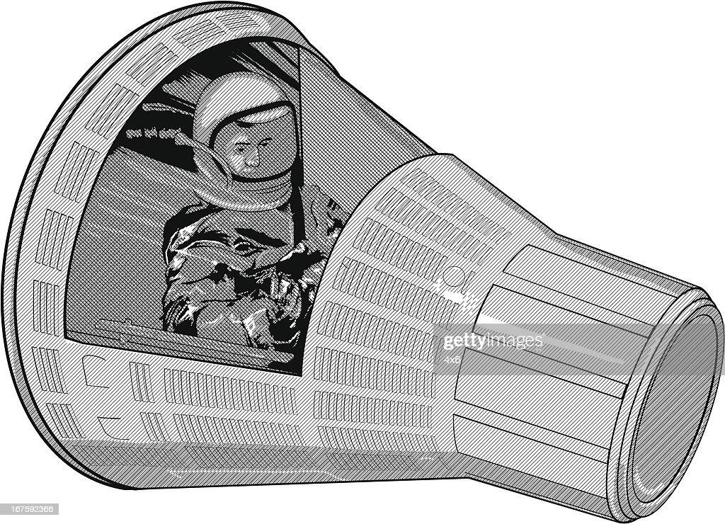 Astronaut in space capsule