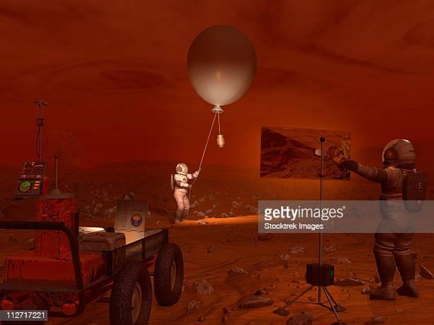 astronauts release a weather balloon on the surface of titan. - weather balloon stock illustrations