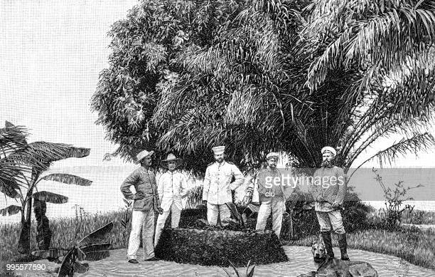 at the grave of a german soldier in cameroon - cameroon stock illustrations, clip art, cartoons, & icons