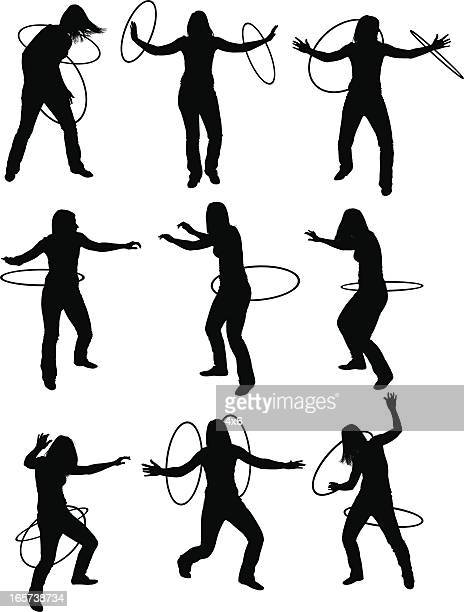 athletic women with hula hoops - plastic hoop stock illustrations