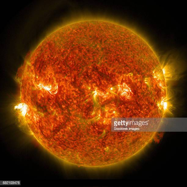 august 24, 2014 - a solar flare erupting on the left side of the sun. this flare is classified as an m5 flare. - solar flare stock illustrations, clip art, cartoons, & icons