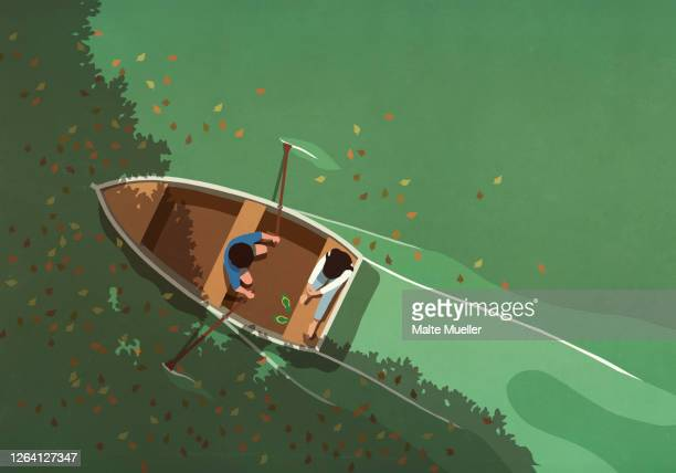 autumn leaves falling around couple in rowboat on lake - transportation stock illustrations