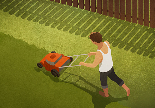 Barefoot man mowing lawn in backyard - gettyimageskorea