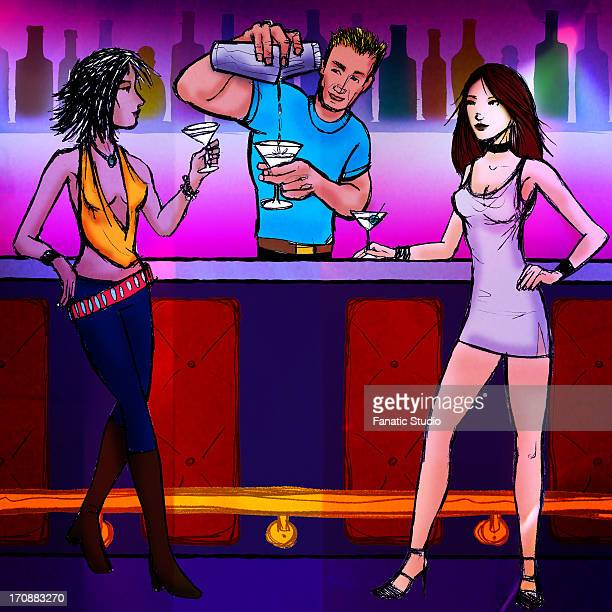 Bartender serving cocktail to two women in a nightclub
