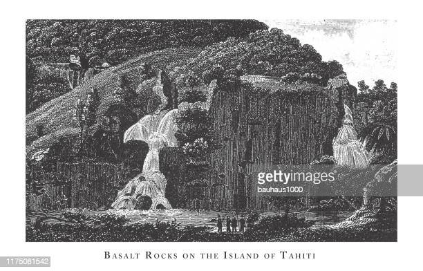 basalt rocks on the island of tahiti, forests, lakes, caves and unusual rock formation engraving antique illustration, published 1851 - basalt stock illustrations, clip art, cartoons, & icons