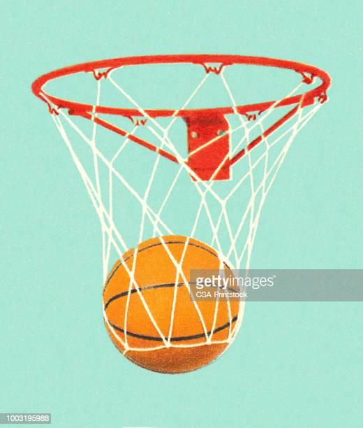 ilustraciones, imágenes clip art, dibujos animados e iconos de stock de baloncesto en un aro de baloncesto - pelota de baloncesto