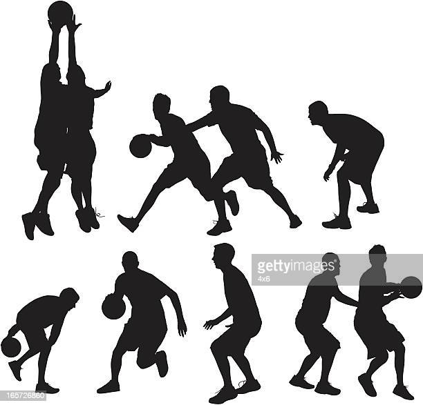 Basketball players playing ball