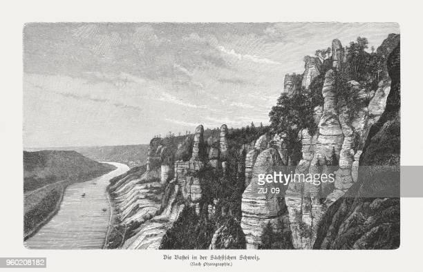 bastei in the saxon switzerland, germany, wood engraving, published 1897 - sandstone stock illustrations, clip art, cartoons, & icons