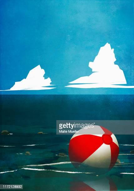 beach ball floating on ocean - tranquil scene stock illustrations