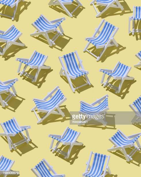 beach chairs on yellow ground, 3d rendering - group of objects stock illustrations