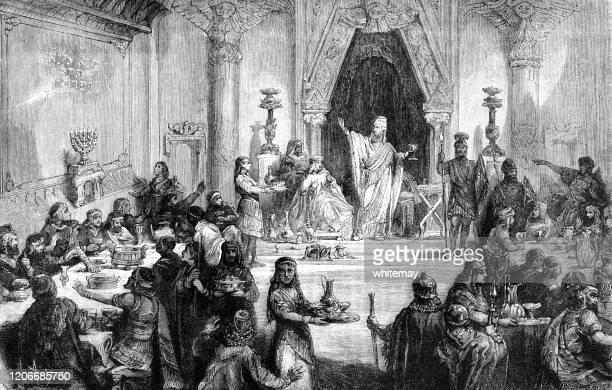belshazzar's feast - biblical event stock illustrations