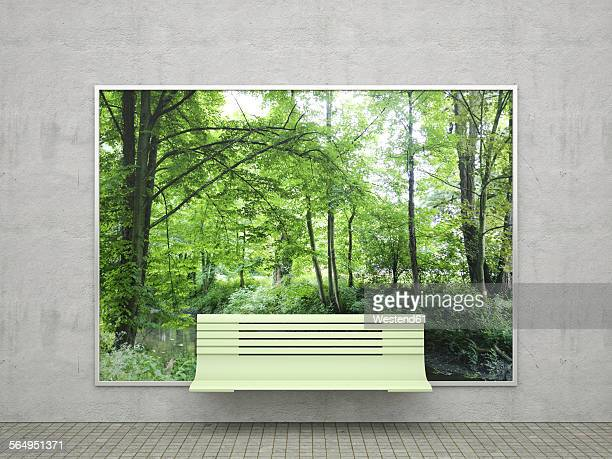 Bench in front of billboard with green trees in forest
