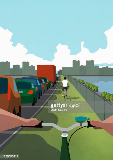 pov bicycles in green lane passing cars in urban traffic jam - road marking stock illustrations