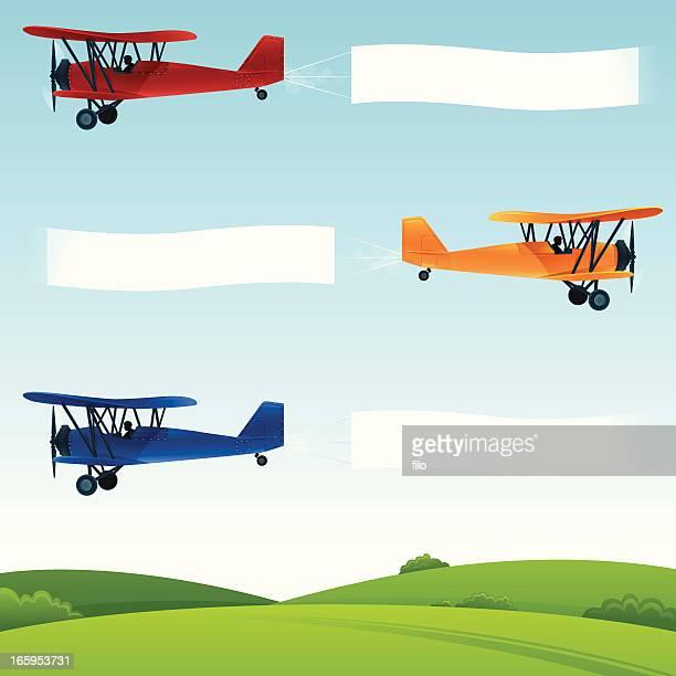 biplane banners - biplane stock illustrations, clip art, cartoons, & icons