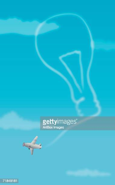 biplane forming a light bulb with its vapor trail - vapor trail stock illustrations, clip art, cartoons, & icons