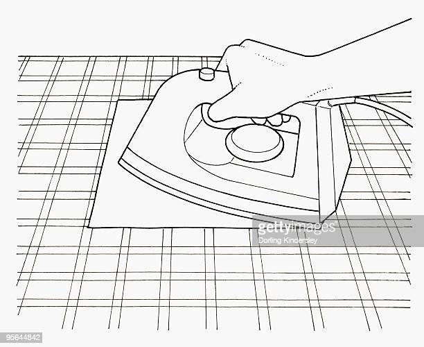 black and white illustration of removing candle wax from tablecloth using warm iron and kitchen pape - paper towel stock illustrations, clip art, cartoons, & icons