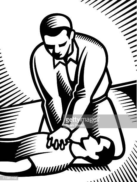 A black and white picture of a man performing CPR