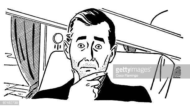 A black and white version of a worried looking man on a train