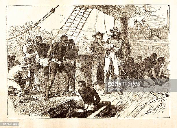 Black slaves loaded on ship 1881