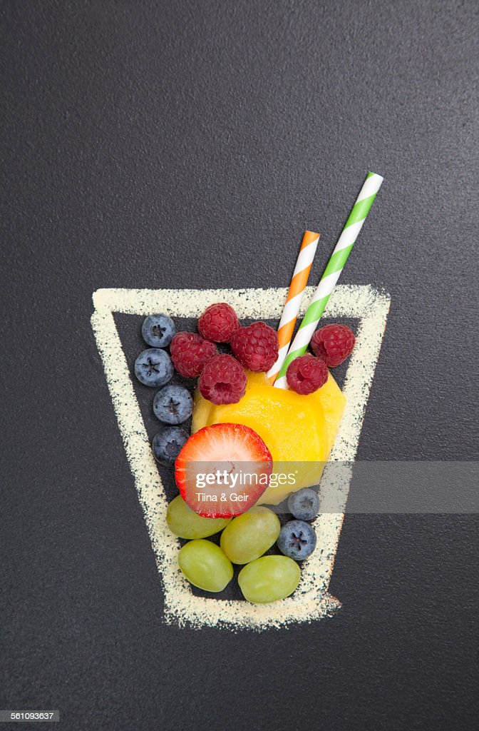 Blackboard illustration of drinking glass with fruit and drinking straws : stock illustration