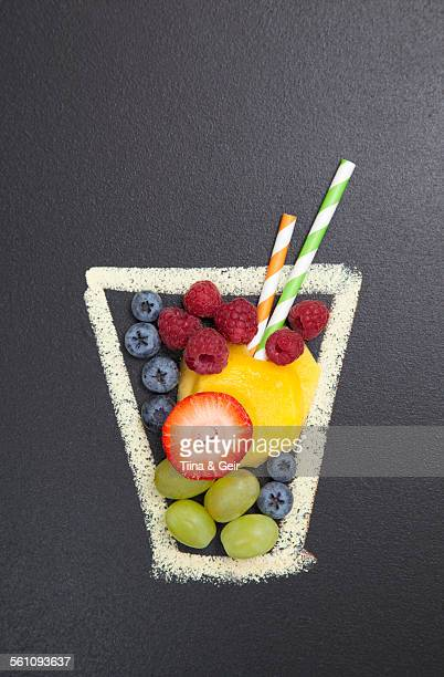 Blackboard illustration of drinking glass with fruit and drinking straws