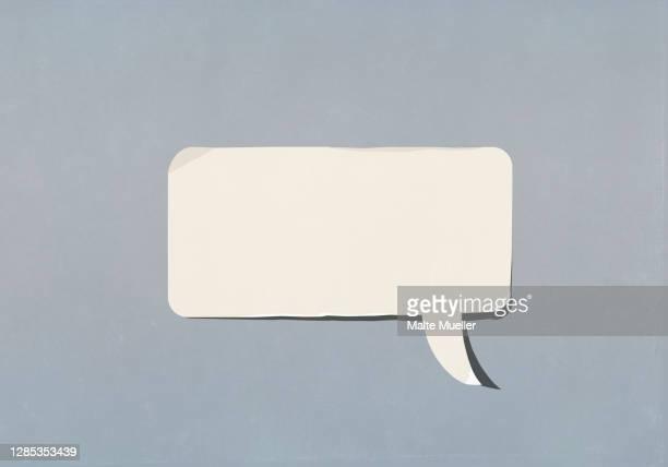 blank speech bubble on blue background - speech bubble stock illustrations
