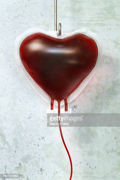 blood bag in shape of a heart - blood bag stock illustrations, clip art, cartoons, & icons