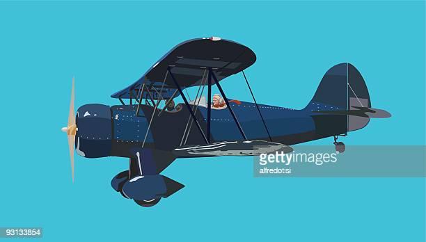 blue biplane - biplane stock illustrations, clip art, cartoons, & icons