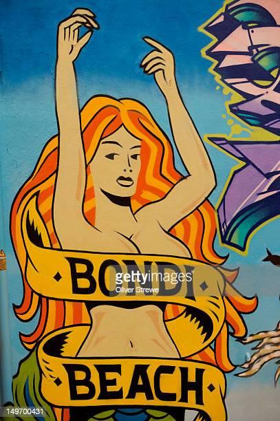 bondi beach mural on bondi road. - capital letter stock illustrations