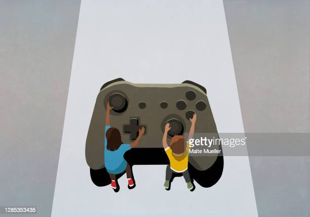 boy and girl playing at large video game controller - {{ contactusnotification.cta }} stock illustrations