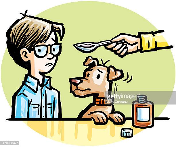 A boy being given a spoonful of medicine