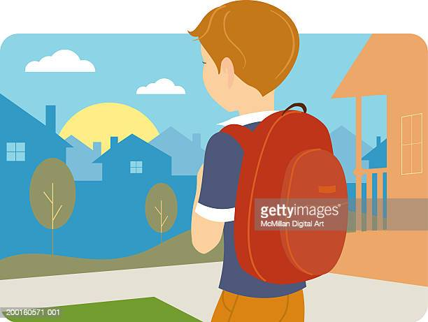 Boy carrying backpack, rear view
