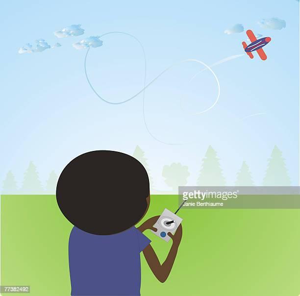 A boy flying a toy airplane