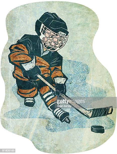 a boy playing ice hockey - ice hockey uniform stock illustrations