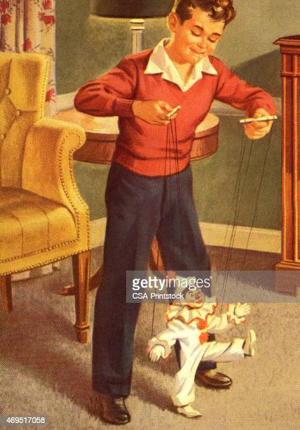 boy playing with a marionette - puppet stock illustrations, clip art, cartoons, & icons