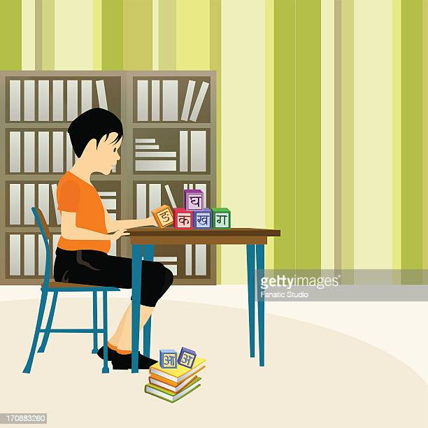 boy playing with alphabet blocks in a library - exercise book stock illustrations