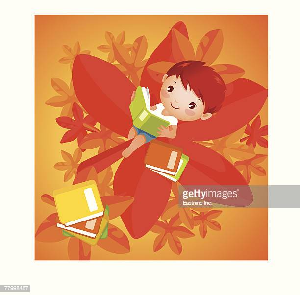 boy reclining on a leaf and reading a book - vor stock-grafiken, -clipart, -cartoons und -symbole