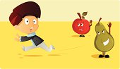 Boy running away from healthy fruits