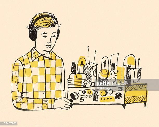 Boy Wearing Headphones and Using Radio